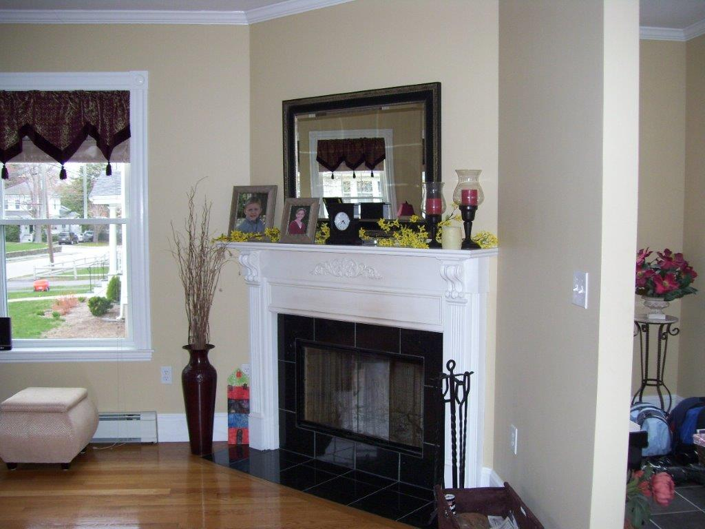 Fireplace with black tile around it side view