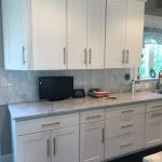 White cupboards with light grey stone top