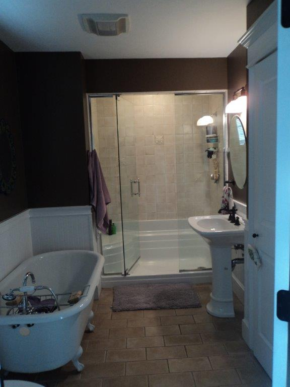 Bathroom with claw foot tub and walk in shower