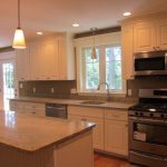 White cupboards with white/gray counter top
